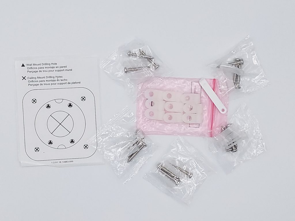 Set de 15 chevilles vis et 9 supports de cable avec un guide de perçcage et une tige pour ouverture du slot pour la carte Miscro SD